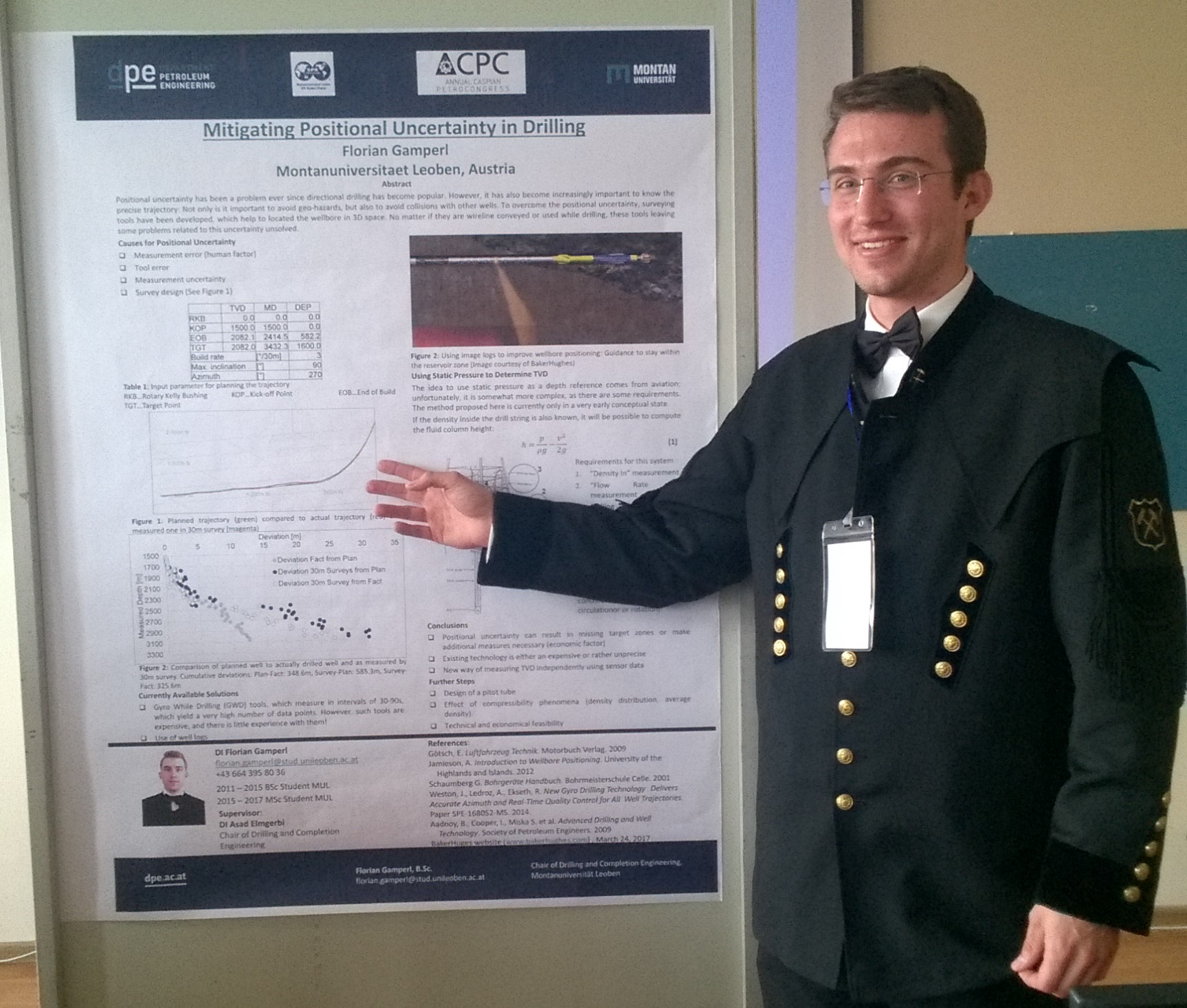 Florian defending his research work in the form of a poster